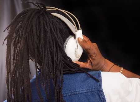 A rastafari singer from behind with headphones photo
