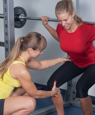 Two Blonde Women   Personal Trainer in a Gym   Two Women make sport Stock Photo