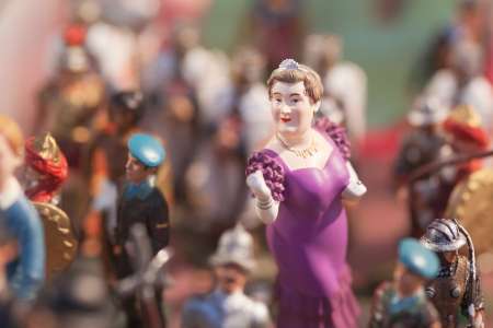 A lot of figures on a jumble market  Detailshot  Focus on Lady face  Stock Photo