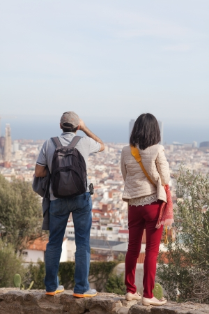 People in parg guell in Barcelona spain looking over Bacelona. They are standing on a view point in Park guell. Stock Photo