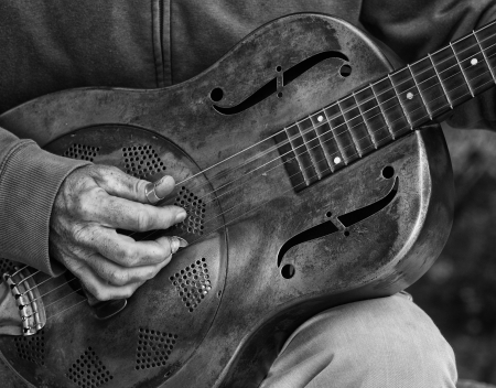 guitar pick: A detail picture of a guitar playing man with a metal - guitar. black abd White high contrast picture Stock Photo
