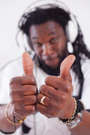 coporate: A rastafari show two thumbs up .Focus on thumbs