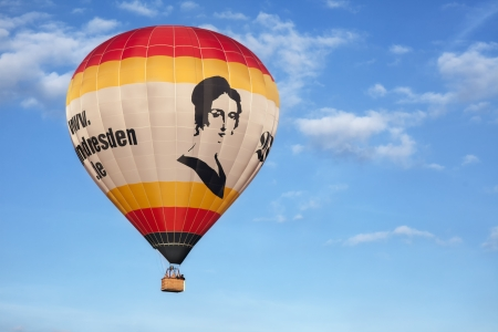 A big captiveballoon in front of bright blue sky. Picture taking in Dresden.