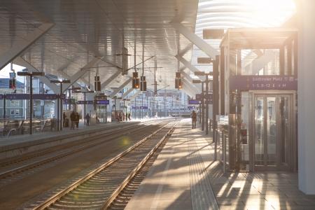 winterday: Salzburg , Dezember 30.2013. Sunset picture of the railwaystation in Salzburg on a Winterday on Sunset. Some poeple waiting for the train..  Dezember 30, 2013 in Salzburg Gaisberg