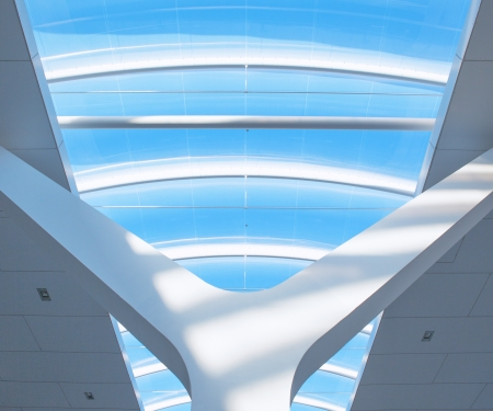 A architectical detail of a glass roof on a railwaystation photo