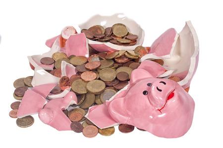 A broken piggybank with chump money