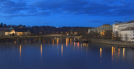 Panorama view from the charles bridge in prague. Beautyful scene in the blue hour. photo