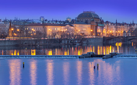 Prague , Czechoslovakia - February 18 . 2014 : Long time exposure of the skyline in Prague on the river. Picture is toned. Made in the Blue hour
