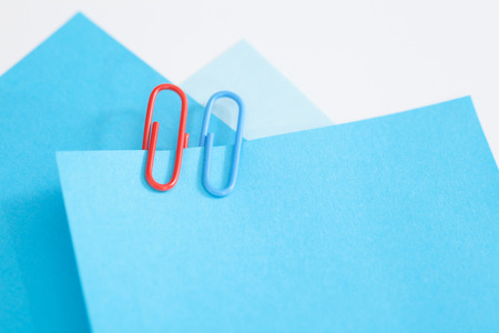 Blue notepads with colored paperclip.Blank paper to use your own concept. photo