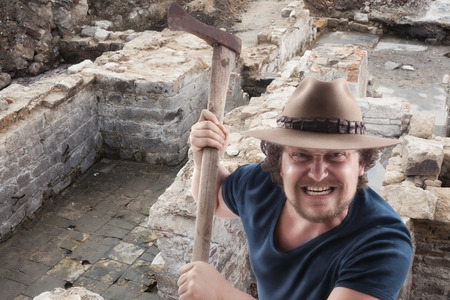 ax man: Angry man attacs with a ax in a ruine . Picture is with dodge and burn effect