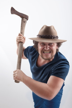 ax man: Angry man attacs with a ax. Picture is with dodge and burn effect Stock Photo