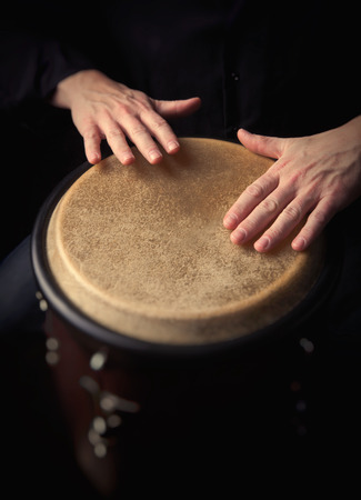 bongo: Motion Picture of a bongo Player. Black background.Picture is toned.