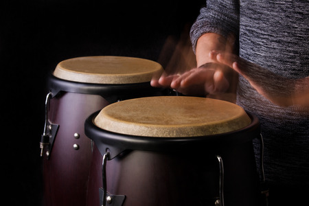 Motion Picture of a bongo Player on Black background photo