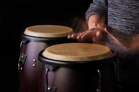 bongo: Motion Picture of a bongo Player on Black background Stock Photo