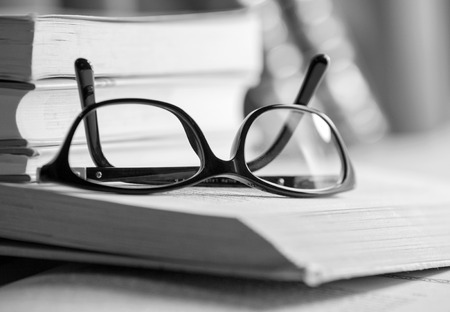 Black and white Picture of glasses on a book photo