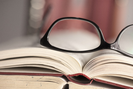 Glasses are laying on a book photo