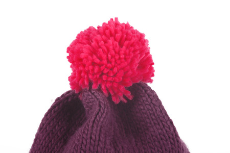 bobble: Red Bobble hat isolated on white. Brown wool cap with a red bobble. Stock Photo