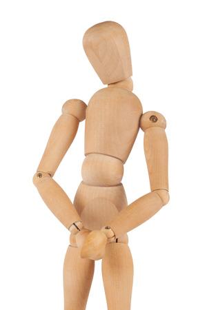 genitali: La figura del manichino si vergogna di qualcosa. Isolati su bianco. Mani di fronte i suoi genitali.
