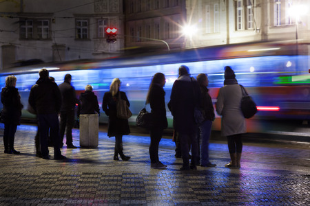 motion picture: A motion picture of people waiting for a  tram in the night . Station near charles bridge.