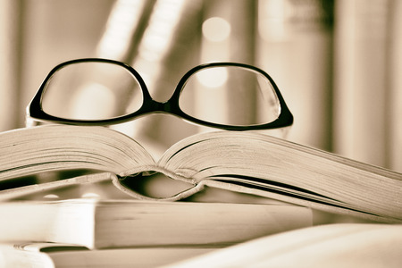 picture book: Black and white Picture of glasses on a book. High contrast.