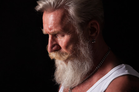 long beard: High defenition portrait of a cool senior man with a white beard.He is wearing a white t-shirt and has tattoos