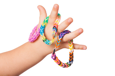 braclets: Child is holding some Loom braclets in her hand Stock Photo