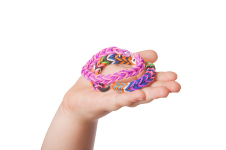 loom: Child is holding some Loom braclets in her hand Stock Photo
