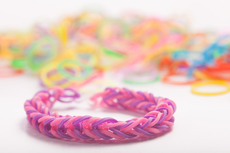 loom: Many rainbow colored  loom rubber rings . Macro Picture
