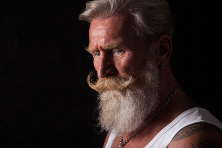 Portrait of a beard man with a long white beard.