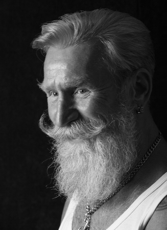 Black and White Portrait of a beard man with a long white beard. Stock Photo