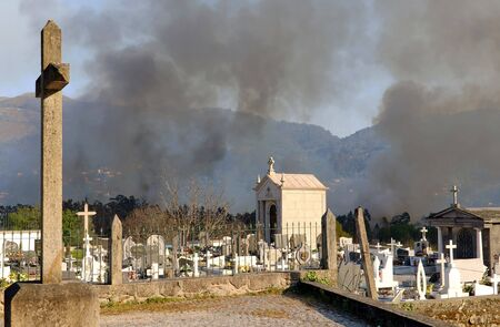 smoke of a wild fire on a cemetary in Portugal