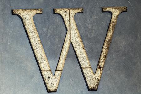 metal sheet: letter W cut in the metal sheet.