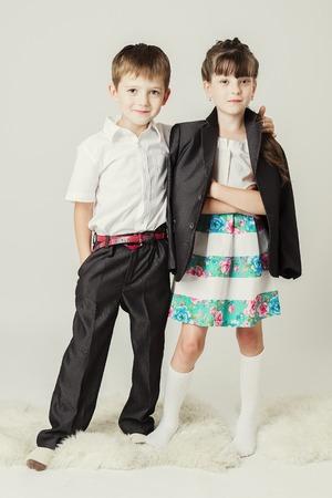 guy portrait: little boy embraces female child for shoulder.