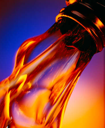 clean motor oil, flowing out of a bottle, colorful background