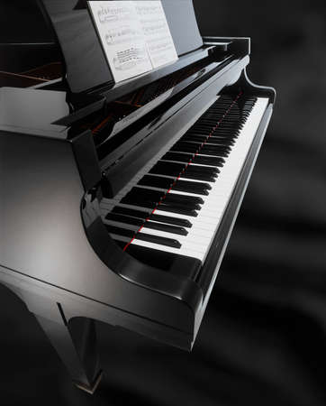 detail of a black piano isolated on black background