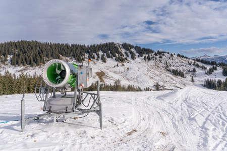 snow gun in the Allgaeu Alps In the Grasgehren Ski area near Balderschwangwaiting for cold weather for producing artificial snow Stock Photo