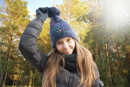 beautiful girl face: Portrait of smiling young girl in cold weather dressed warm hat