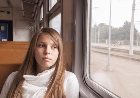 sedentary: Girl on the train looking out the window