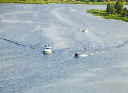 motor boats: Three motor boats on river in summer