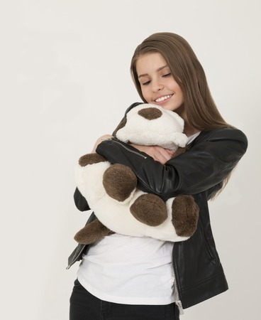 soft toy: Smiling teenage girl with cute soft toy