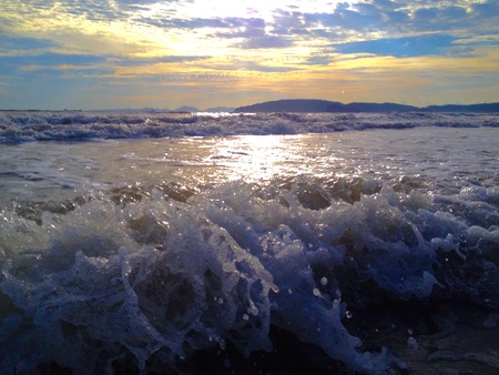 The beautiful waves are on the beach.