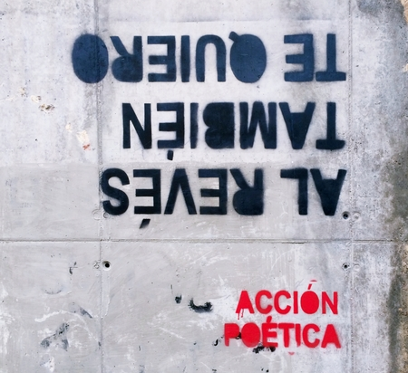 Artistic current of poets and thinkers who write with curious spray poetically correct phrases, philosophical or amorous tone, in urban walls of cities. I love you also upside down.