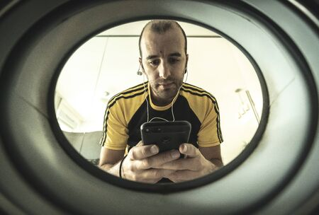 Portrait from inside a washing machine to a young sportsman