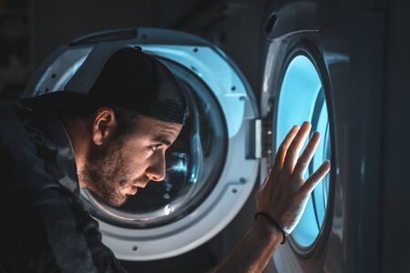 A brave young man facing his nightmares. spaceship simulation Stockfoto