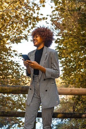 A Dominican girl with Afro hair in a technology session, sending an audio message Stock Photo