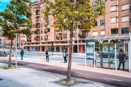 San Sebastian, Gipuzkoa / Spain »; April 30, 2020: Social distance between people waiting for the bus