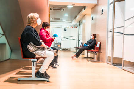 San Sebastian, Gipuzkoa / Spain »; April 30, 2020: Social distance of a group of people in medical consultations