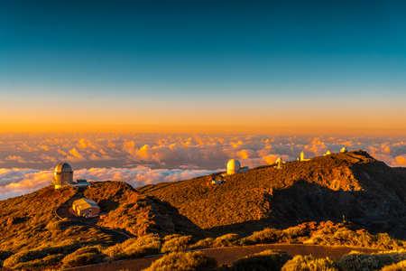 Observatories of Roque de los Muchachos in the Caldera de Taburiente in a beautiful orange sunset, La Palma, Canary Islands. Spain