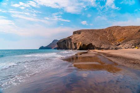 Rock walls of the coast of Playa de Monsul in the natural park of Cabo de Gata, Nijar, Andalucia. Spain, Mediterranean Sea