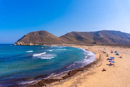 The beautiful beach in summer of Playazo de Rodalquilar in the natural park of Cabo de Gata, Nijar, Andalucia. Spain, Mediterranean Sea